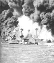 The American battleships West Virginia and Tennessee under attack at Pearl Harbor.