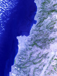 Image from space, Jiyyeh oil slick in darkest blue; picture centered on Beirut. August 10, 2006