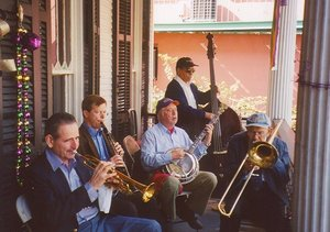 A traditional jazz band plays for a party in New Orleans in 2005. Shown are Chris Clifton, trumpet; Brian O'Connell, clarinet; Les Muscutt, banjo; Chuck Badie, string bass; and Tom Ebert, trombone. Other instruments often found in this type of band are the piano and drums.