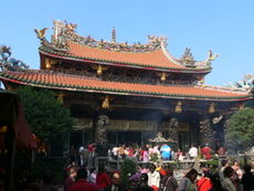 Longshan Temple in Taipei City with the entrance facing west; an example of architecture with southern Chinese influences commonly seen in older buildings in Taiwan (1738).