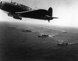 A Vought SB2U scout bomber from USS Ranger (CV-4) flies anti-submarine patrol over the Convoy WS12, en route to Capetown, 27 November 1941