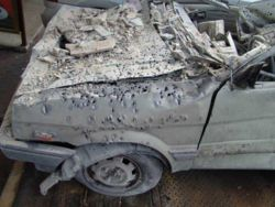 A car in Haifa following rocket attack on 17 July 2006 showing result of anti-personnel shrapnel. Such attacks killed 43 Israeli civilians and injured 4,262 others.