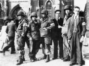 Members of the Dutch Eindhoven Resistance with troops of the U.S. 101st Airborne in front of the Eindhoven cathedral during Operation Market Garden in September 1944.