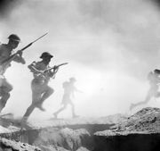 Members of the 9th Australian Infantry Division in a posed photograph during the Second Battle of El Alamein. (Photographer: Len Chetwyn.)