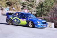 Stephane Sarrazin driving a Subaru Impreza WRC on the Monte Carlo Rally