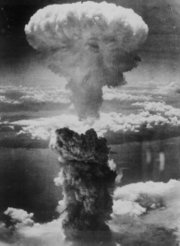 The mushroom cloud resulting from the nuclear weapon known as Fat Man rises 18 km (11 mi, 60,000 ft) over Nagasaki from the nuclear explosion hypocenter.