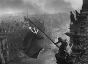 "Red Army soldiers on the Reichstag, Berlin, raising the ""Victory Banner"" after the fall of Nazi Germany (picture by Evgueni Khaldey)"