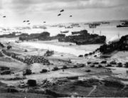 Supplies coming ashore on Normandy.