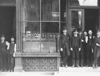 The Grit office as it looked in the 1890s: Publisher Dietrick Lamade is fifth from right, with the mustache.