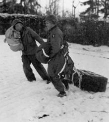 101st Airborne troops retrieving air dropped supplies during the Battle of Bastogne.