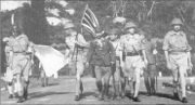 Lieutenant-General Arthur Percival, led by a Japanese officer, marches under a flag of truce to negotiate the capitulation of Allied forces in Singapore, on February 15, 1942. It was the worst defeat in British history.