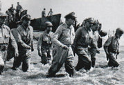 """I have returned."" — A famous photo of Gen. MacArthur coming ashore back to the Philippines. Photo taken by Carl Mydans of Life magazine."