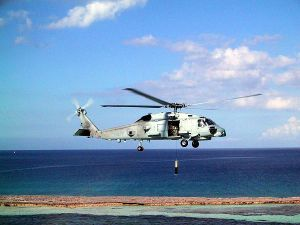 An MH-60R conducts an airborne low frequency sonar (ALFS) operation during testing and evaluation.