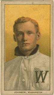 Walter Johnson on a 1909-1911 American Tobacco Company baseball card (White Borders (T206)).
